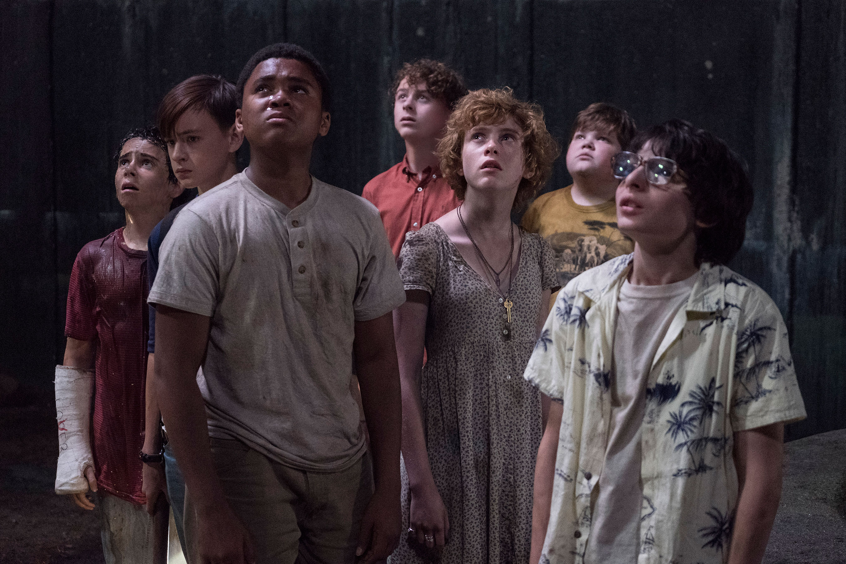 The Losers Club from 2017's It look on as It's victims float above them.(It, 2017)