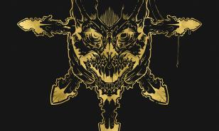 A golden skull set on a pirate's wheel on a black leather surface