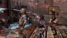 The Middle-earth game has a combat similar very similar to the Batman: Arkham series.