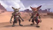 Two Vulpera stand among the barren desert.