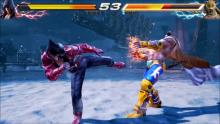 Using a popping kick, Jin applies horizontal pressure to King.