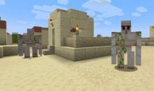 An iron golem in a desert village