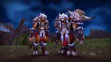 Two primitively clothed Tauren stand idly