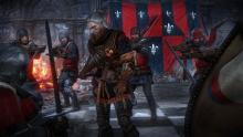 Geralt surrounded by enemies. He can deal with all of them if he really wants to.