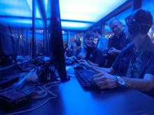 The team has some fun in their gaming booth before their next match.