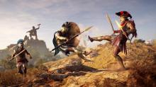 Alexios boots an enemy from atop a hill in Assassin's Creed: Odyssey