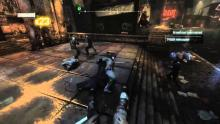 Batman fights several crooks in Arkham City.