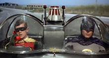 What did Batman say to Robin before he got into the car? Robin, get in the car.