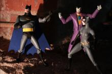 Batman standing against the Joker while Catwoman watches. Whom will she side with?