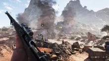 A Recon player reloads while under artillery fire.
