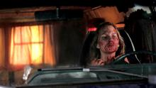 Eve drives with a bloody face