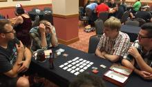People playing Codenames at a convention
