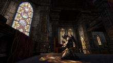 A player character praying in one of the city's temples.