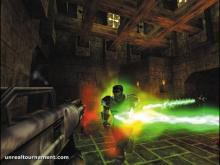 A player in unreal tournament blasts pulse beam energy at an opponent