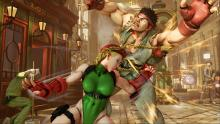 Ryu. Cammy. A man with a broom and a bucket on his head. Exasperated gentleman in the background.  This scene has it all.