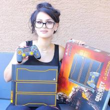 Unboxing the Call of Duty: Black Ops III-themed PS4. (from https://www.facebook.com/SSSniperWolf/photos/a.410430455744903.1073741829.388887381232544/856696814451596/?type=3&theater)