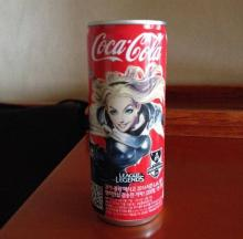 Coca Cola can from Korea. Features Lux.