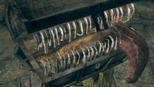 Does that chest you are about to open appear to be breathing? If so, don't open it! Veterans of the Dark Souls series know to inspect chests before attempting to loot them, lest they be chomped to death.