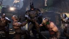 Batman breaking the hands of some thugs in Batman: Arkham City