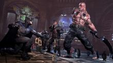 Batman fighting some goons in Batman: Arkham City