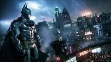 Batman watching over Gotham City in Batman: Arkham Knight