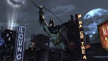 Batman using his grappling hook in Batman: Arkham Origins