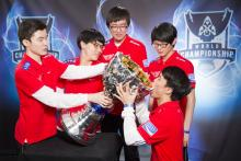 SKTT1 being silly with their new trophy, the Summoner's Cup.