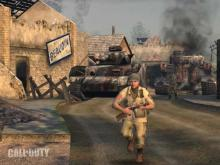 A snapshot from the first ever Call of Duty game, a war scene featuring tanks and barricades.