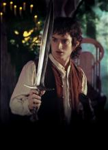 Frodo Admiring the Sword Bilbo Gave Him