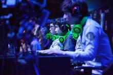 Pro gamers in the heat of competition,  focus completely on their task at hand.