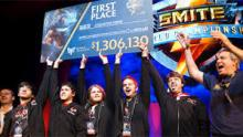 Smite esport team, Cognitive Prime hoist a pretty hefty check after a large tournament win.