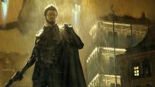Adam Jensen swamped in the series' distinctive sepia-tinted color palette.