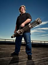 Gabe Newell Wielding a minigun