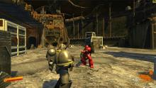 A Chaos Space Marine is staring down the barrel of a Heavy Bolter wielding Devastator Space Marine...