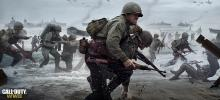 A soldier helps a buddy through the chaos and obstacles of the battlefield on the landing beach.