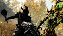A warrior in daedric armor swings a mace at an angry Spriggan.