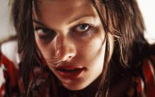 Milla Jovovich's character can be considered as a representation of the people who don't play the Resident Evil video games.