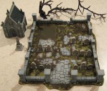 A graveyard complete with bare trees for minis to creep through.