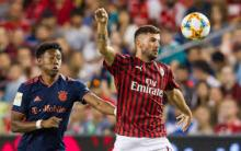 Patrick Cutrone blocks out his opponent to get to the ball