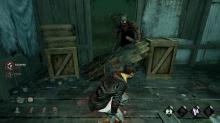 Meg tries to escape the Trapper by vaulting over a pallet.