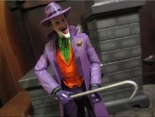 Armed with a crowbar, the Joker is preparing to bash someone's head in.
