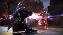 A Warlock holds off an invader Titan.