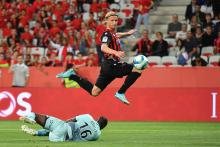 Kasper Dolberg dodges his opponent to continue his attack