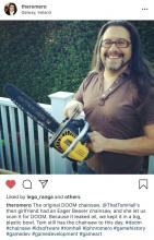 Romero, one of the fathers of the FPS genre, can be seen here holding the chainsaw they used to model the original DOOM's chainsaw on.