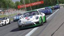Porsche 911's racing closely.