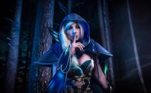 A beautiful Drow Ranger cosplay using her signature ability, silence.