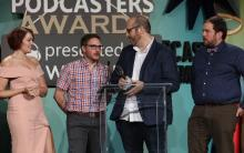 Drunks and Dragons Hosts Accepting the Podcasters Awards Best Gaming Award