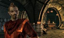 A Dark Elf plotting his next move in a tavern.