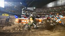 A pack of racers round a muddy corner in MX vs. ATV Supercross Encore!