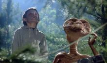 Elliot and E.T. look to the sky